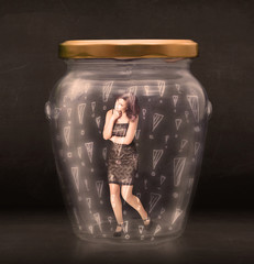 Business woman trapped in jar with exclamation marks concept