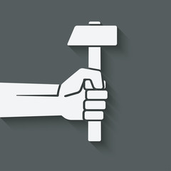 working symbol hand with hammer