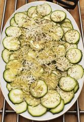 Sliced raw courgettes carpaccio