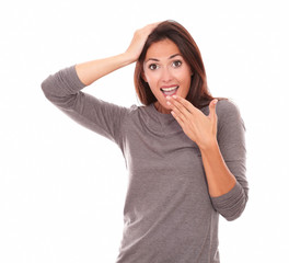 Surprised woman holding mouth and looking at you