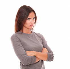 Unhappy brunette in grey blouse looking angry