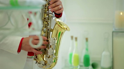 man in festive costume plays saxophone