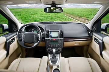 Sand colored SUV car interior in the fields