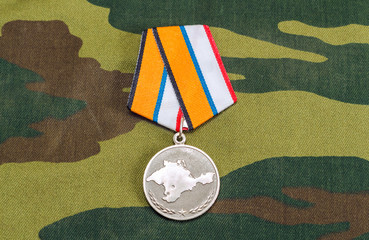 Medal for the return of the Crimea on camouflage background