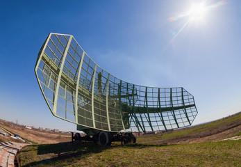 Military russian radar station against blue sky