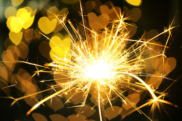 Beautiful sparkler on shiny background, close up