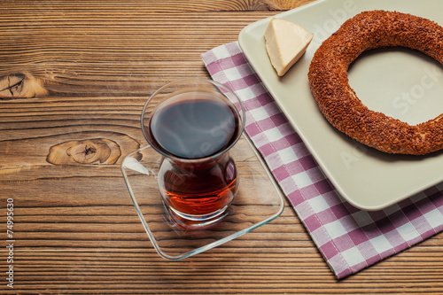Leinwandbild Motiv simit Ӏ turkish bagel, tea and cheese on wood table