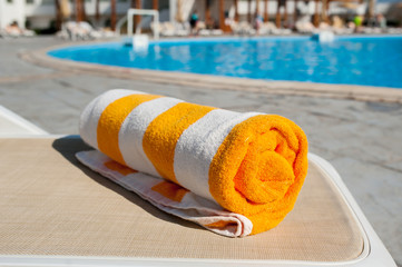 beach towel on the bright sun lounger