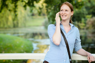 Woman on the Phone in a City Park
