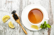 Cup of tea with lemon and mint - 74996800