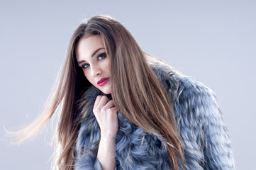 Winter fashion woman in a fur coat.