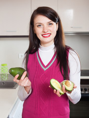 Portrait of smiling girl with avocado