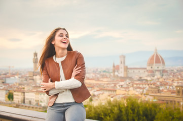 Beautiful girl impressed view the panorama of Florence in autumn