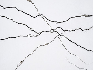 cracks on concrete wall creating lines