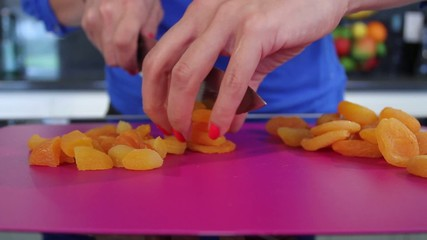 Female hands cutting Mandarin Oranges with knife