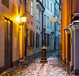 Narrow medieval street in old Riga city, Latvia, Europe