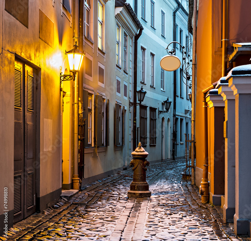 Narrow medieval street in old Riga city, Latvia, Europe - 74998810