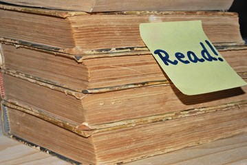 """Pile of books with """"read"""" note"""