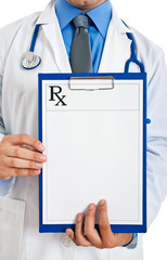 Doctor holding prescription paper