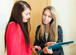 woman filling questionnaire for young employee