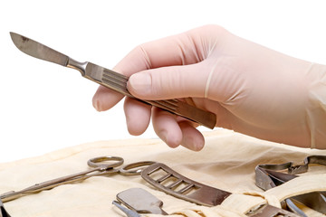 Hand with scalpel