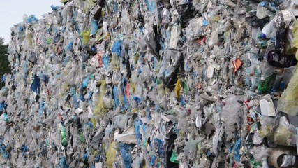 Stack of recycled plastic, disposable bags at recycling plant