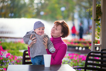 Middle aged woman and her adorable grandson