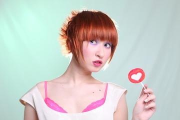 redhead girl with lollipop heart horizontally