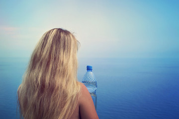 girl and a bottle of water