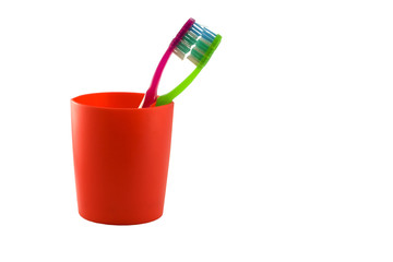 Two toothbrushes in glass