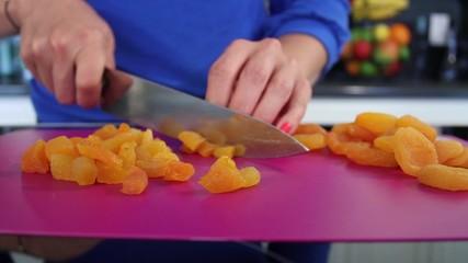 Female hands cutting Mandarin Oranges in pieces