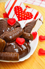 Cup of coffee with chocolate sweets a valentine heart on white p