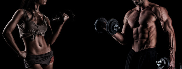 strong young couple working out with dumbbells. Shot in studio o © romanolebedev