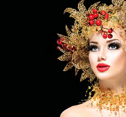 Christmas winter girl with golden hairstyle and makeup