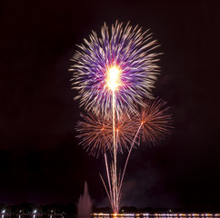colorful holiday fireworks in the night sky