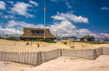 Sand dunes and houses in Ocean City, New Jersey.