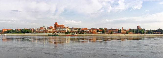Torun old town reflected in Vistula river, Poland