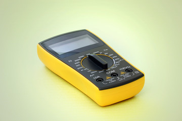 Digital multimeter on a green background