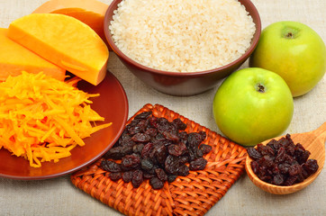 ripe raw pumpkin with grated pumpkin, apples and heap of raisins