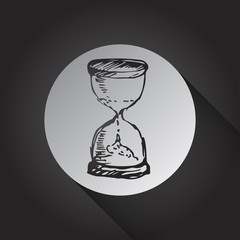 Hourglass icon on black background.