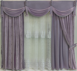 Window decoration in purple tones.