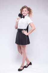 girl in skirt and jacket smiles