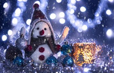 Snowman brought Christmas balls