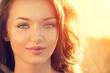 Beauty girl outdoors. Teenage girl smiling in sun light