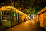 Fototapety Narrow brick alley at night, in St. Augustine, Florida.