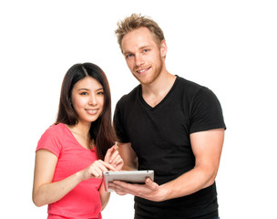 Asian girl and caucasian boy happy standing and using their tabl