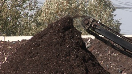 Compost production at recycling plant.