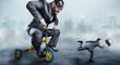Leinwanddruck Bild - Nerdy businessman riding a small bicycle