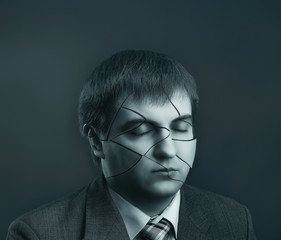 Businessman head with cracks on his face