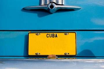 Cuban Yellow Plate on Blue Car